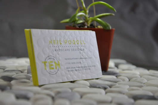 uncoated business card with emboss and color edges
